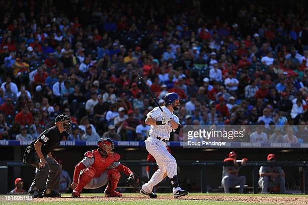 Todd Helton of the Colorado Rockies takes an at bat as catcher Tony Cruz of the St Louis Cardinals backs up the plate and homeplate umpire Vic...