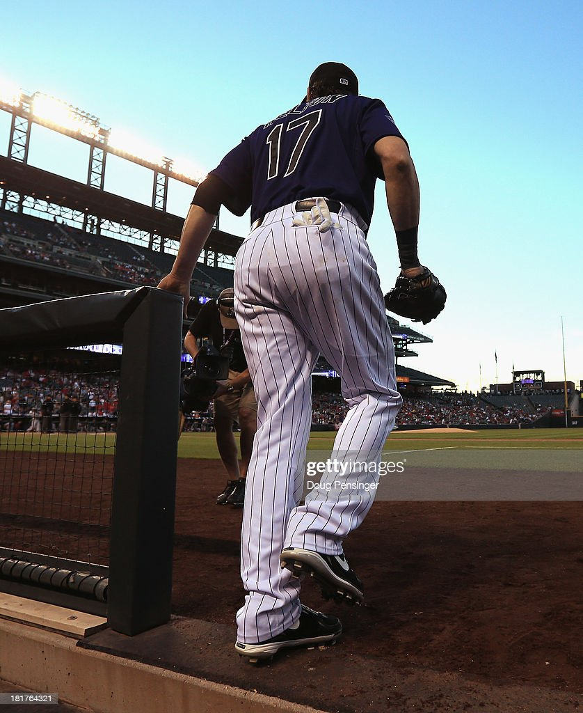 <a gi-track='captionPersonalityLinkClicked' href=/galleries/search?phrase=Todd+Helton&family=editorial&specificpeople=200735 ng-click='$event.stopPropagation()'>Todd Helton</a> #17 of the Colorado Rockies takes the field against the Boston Red Sox on the eve of his final game home game at Coors Field on September 24, 2013 in Denver, Colorado. The Rockies defeated the Red Sox 8-3.