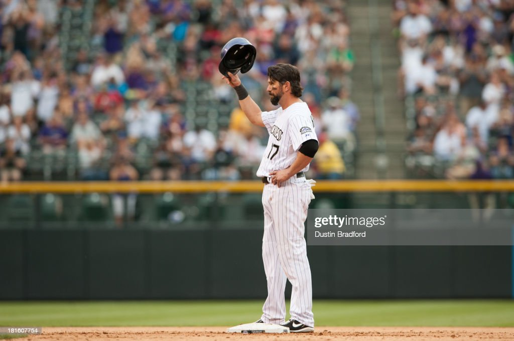 <a gi-track='captionPersonalityLinkClicked' href=/galleries/search?phrase=Todd+Helton&family=editorial&specificpeople=200735 ng-click='$event.stopPropagation()'>Todd Helton</a> #17 of the Colorado Rockies tips his hat to acknowledge cheers after it was announced that the two runs he knocked in with a fifth inning double resulted in Helton's 1400th RBI against the Arizona Diamondbacks at Coors Field on September 22, 2013 in Denver, Colorado.