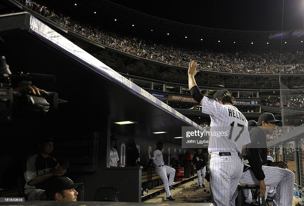 Todd Helton (17) of the Colorado Rockies waves to the crowd as he enters the dugout after walking off the field at the end of the game against the Boston Red Sox September 25, 2013 at Coors Field. Helton will retire at the end of the season after 17 years with the club.