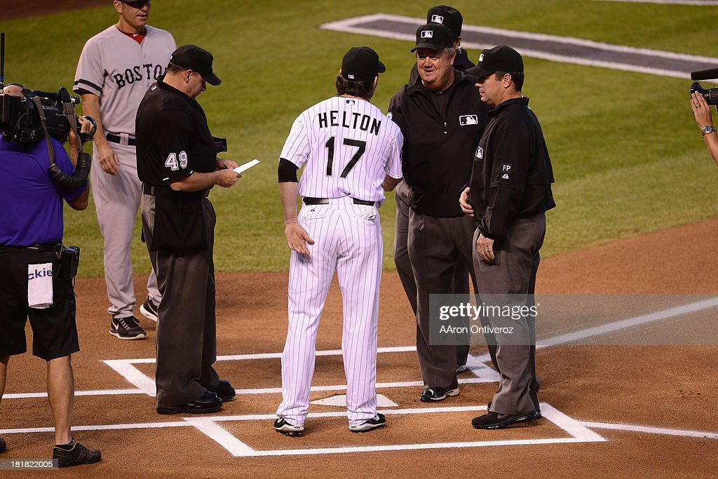 Todd Helton shakes hands with the crew of umpires before the start of action in Denver. The Colorado Rockies hosted the Boston Red Sox and said farewell to longtime first baseman Todd Helton, who recently announced his retirement following this season.