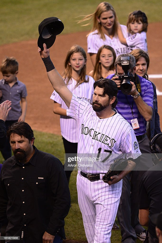 Todd Helton tips his cap to the crowd before the start of action in Denver. The Colorado Rockies hosted the Boston Red Sox and said farewell to longtime first baseman Todd Helton, who recently announced his retirement following this season.