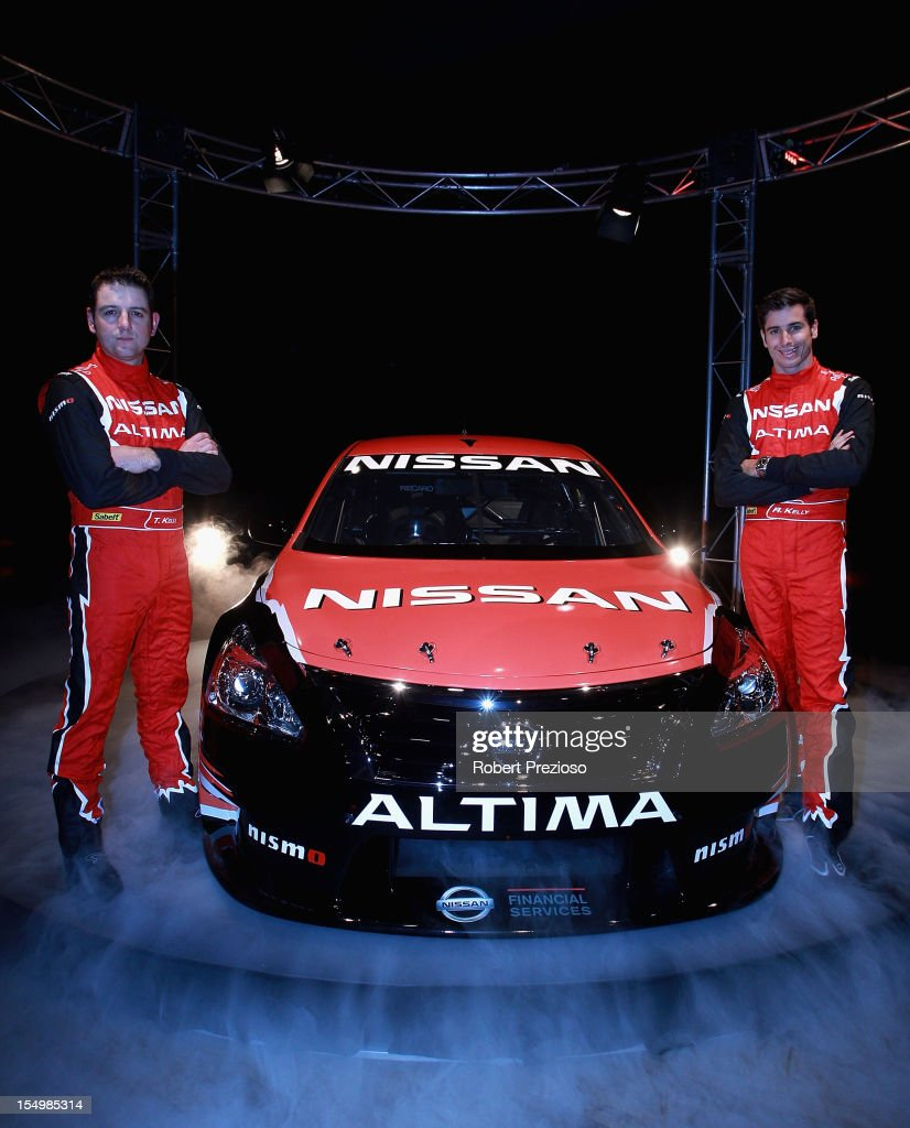 Todd Kelly and Rick Kelly pose for photos during the Nissan V8 Supercar launch at Maia on October 30, 2012 in Melbourne, Australia.