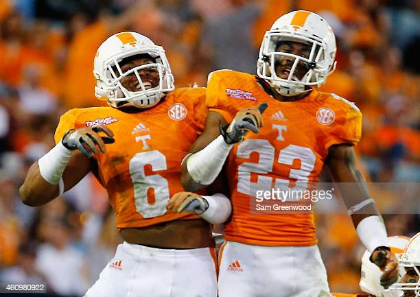 Todd Kelly Jr #6 and Cameron Sutton of the Tennessee Volunteers celebrate a defensive play during the TaxSlayer Bowl against the Iowa Hawkeyes at...