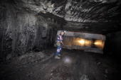 Todd Leverton a superintendent with MaRyan Mining LLC walks through a coal seam at Foresight Energy LLC's Shay coal mine in Carlinville Illinois US...