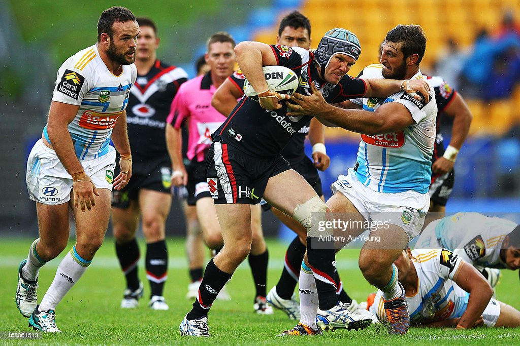 Todd Lowrie of the Warriors charges against David Taylor of the Titans during the round eight NRL match between the New Zealand Warriors and the Gold Coast Titans at Mt Smart Stadium on May 5, 2013 in Auckland, New Zealand.