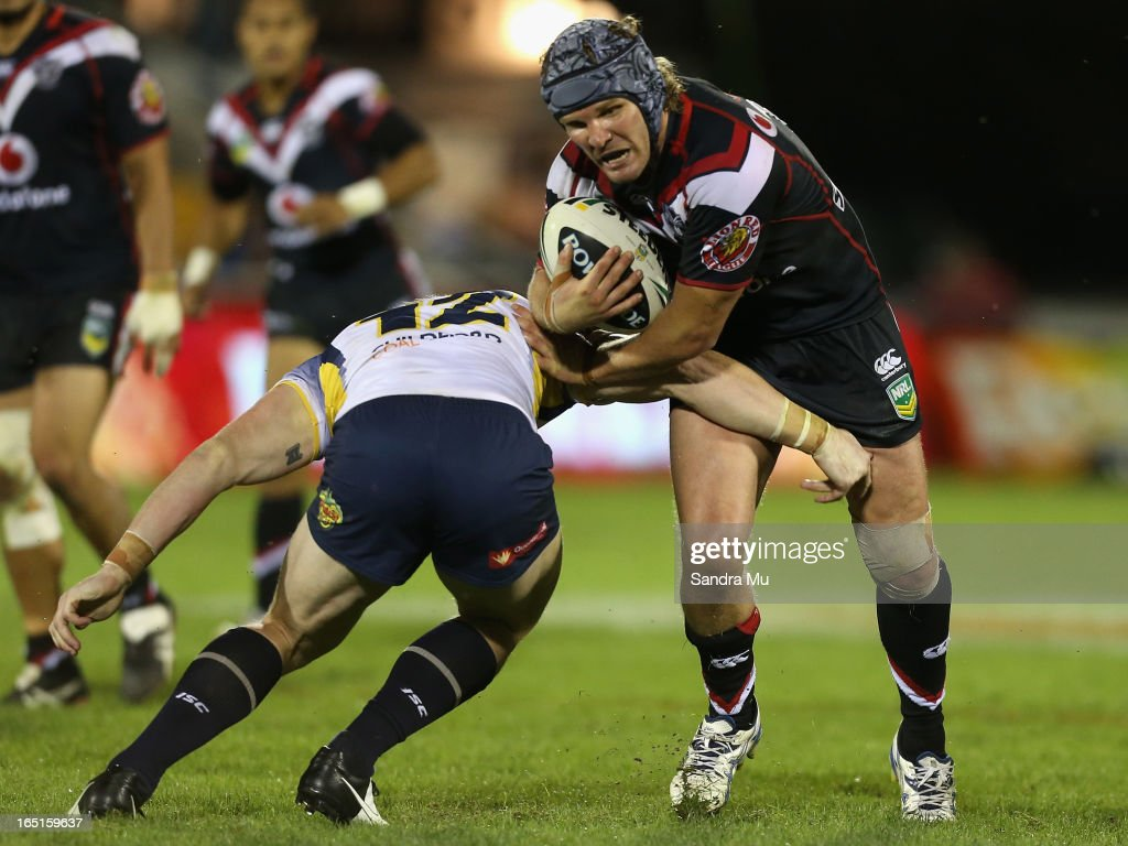 Todd Lowrie of the Warriors is tackled during the round four NRL match between the New Zealand Warriors and the North Queensland Cowboys at Mt Smart Stadium on April 1, 2013 in Auckland, New Zealand.
