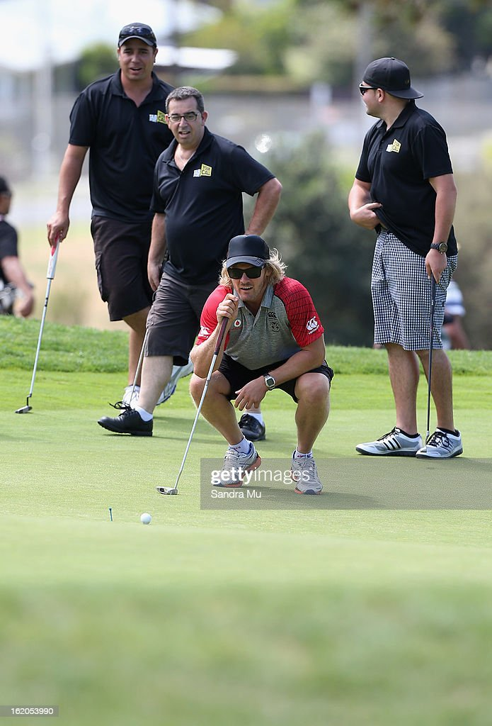 Todd Lowrie of the Warriors lines up a putt during a New Zealand Warriors NRL golf day at Titirangi Golf Club on February 19, 2013 in Auckland, New Zealand.
