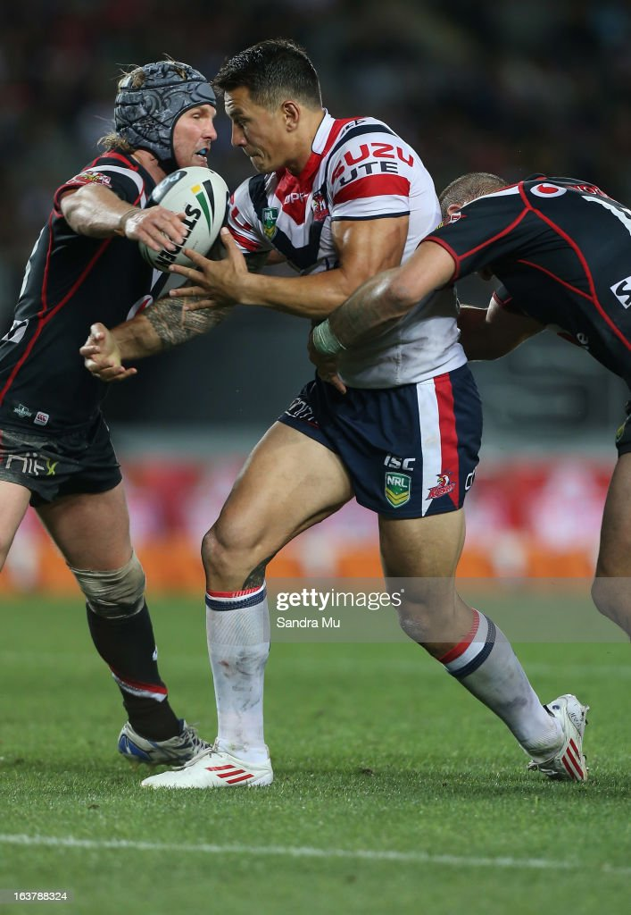 Todd Lowrie of the Warriors (L) tackles <a gi-track='captionPersonalityLinkClicked' href=/galleries/search?phrase=Sonny+Bill+Williams&family=editorial&specificpeople=204424 ng-click='$event.stopPropagation()'>Sonny Bill Williams</a> of the Roosters during the round two NRL match between the New Zealand Warriors and the Sydney Roosters at Eden Park on March 16, 2013 in Auckland, New Zealand.