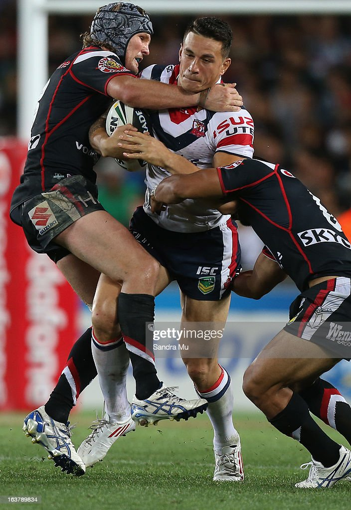 Todd Lowrie of the Warriors (L) tackles Sonny Bill Williams of the Roosters during the round two NRL match between the New Zealand Warriors and the Sydney Roosters at Eden Park on March 16, 2013 in Auckland, New Zealand.