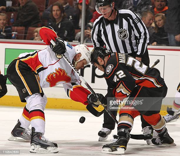 Todd Marchant of the Anaheim Ducks battles for the puck in a face off against Olli Jokinen of the Calgary Flames during the game at Honda Center on...
