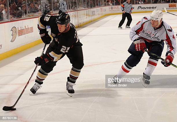 Todd Marchant of the Anaheim Ducks handles the puck as John Erskine of the Washington Capitals trails during the game on November 19 2008 at Honda...