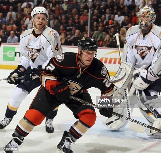 Todd Marchant of the Anaheim Ducks races for the puck outside the crease against the Nashville Predators in Game One of the Western Conference...