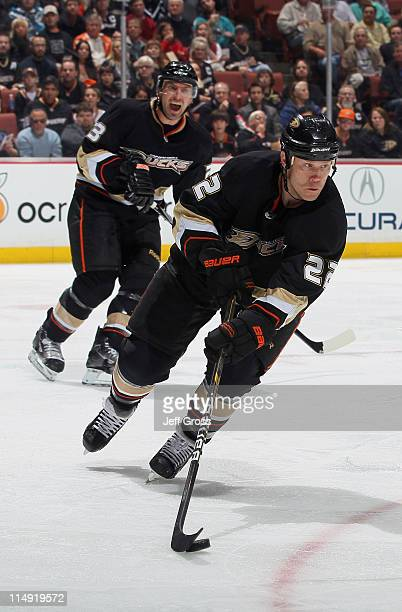 Todd Marchant of the Anaheim Ducks skates with the puck as teammate Francois Beauchemin yells to him against the San Jose Sharks at Honda Center on...