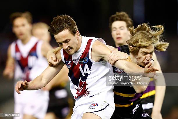 Todd Marshall of the Bushrangers tackles Liam Murphy of the Dragons during the TAC Cup Grand Final match between the Murray Bushrangers and the...