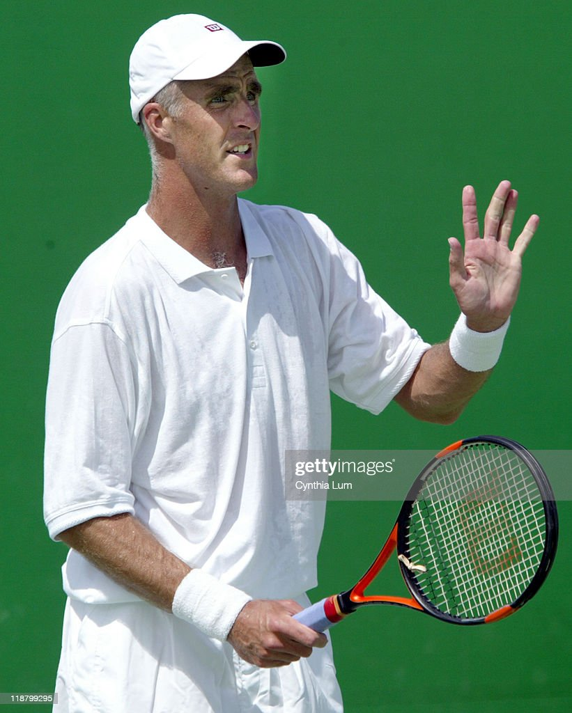 <a gi-track='captionPersonalityLinkClicked' href=/galleries/search?phrase=Todd+Martin&family=editorial&specificpeople=209234 ng-click='$event.stopPropagation()'>Todd Martin</a> defeating newcomer <a gi-track='captionPersonalityLinkClicked' href=/galleries/search?phrase=Ivo+Karlovic&family=editorial&specificpeople=605320 ng-click='$event.stopPropagation()'>Ivo Karlovic</a> 7-6, 7-6, 7-6 in the second round of the Australian Open, Melbourne January 21, 2003.