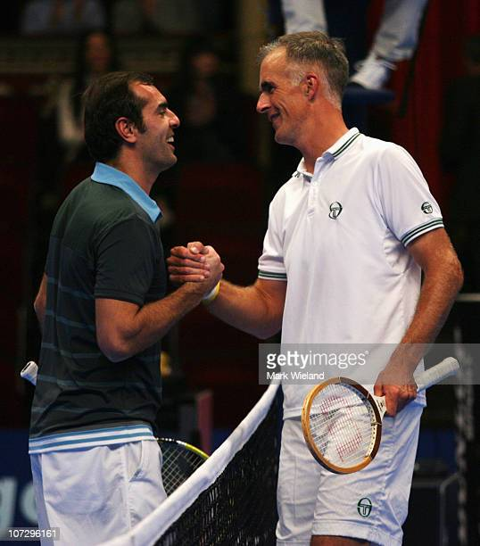 Todd Martin of the United States and Cedric Pioline of France shake hands after their match on day four of the AEGON Masters at Royal Albert Hall on...