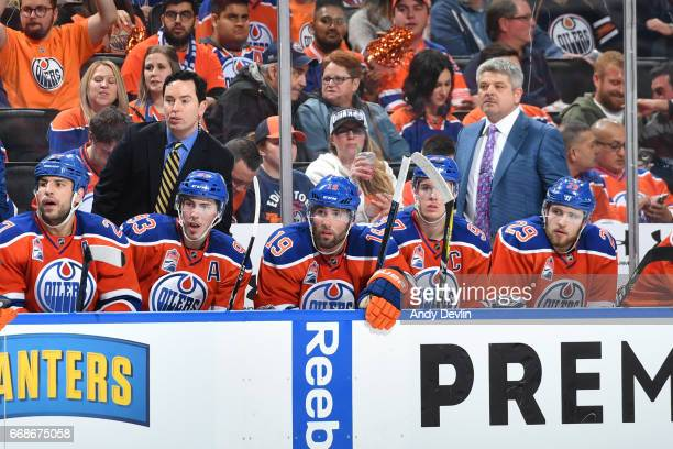 Todd McLellan and Jay Woodcraft of the Edmonton Oilers watch play from the bench in Game Two of the Western Conference First Round during the 2017...