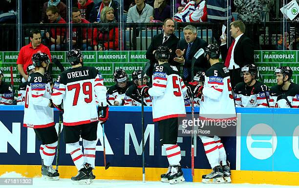 Todd McLellan hed coahc of Canada gives instructions to the team during the IIHF World Championship group A match between Canada and Latvia at o2...