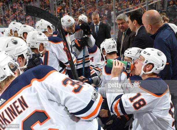 Todd McLellan of the Edmonton Oilers discusses the play with the players during the preseason game against the Winnipeg Jets on September 23 2017 at...
