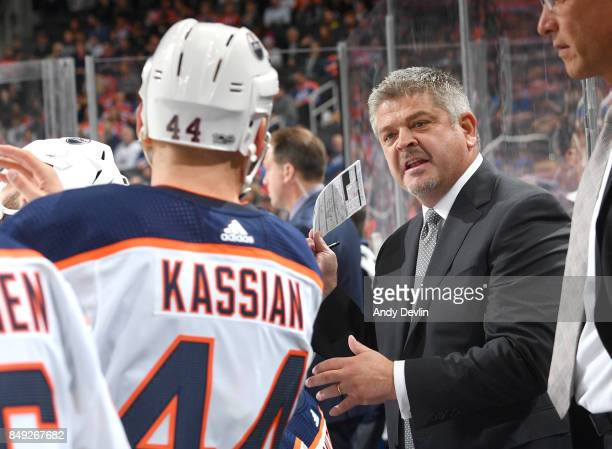 Todd McLellan of the Edmonton Oilers speaks to Zack Kassian during the preseason game against the Calgary Flames on September 18 2017 at Rogers Place...