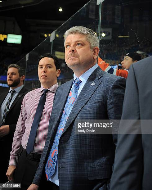 Todd McLellan of the Edmonton Oilers stands for the singing to the national anthem prior to the game against the Vancouver Canucks on April 6 2016 at...