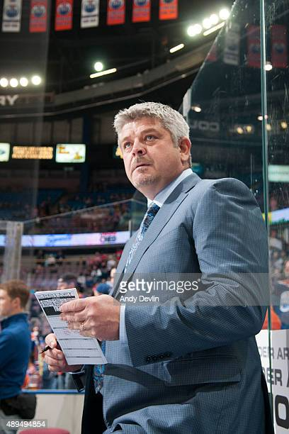 Todd McLellan of the Edmonton Oilers watches warm up from the bench prior to a game against the Calgary Flames on September 21 2015 at Rexall Place...