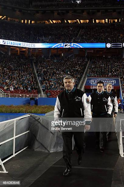 Todd McLellan of the San Jose Sharks enters the rink against the Los Angeles Kings at Levi's Stadium on February 21 2015 in Santa Clara California