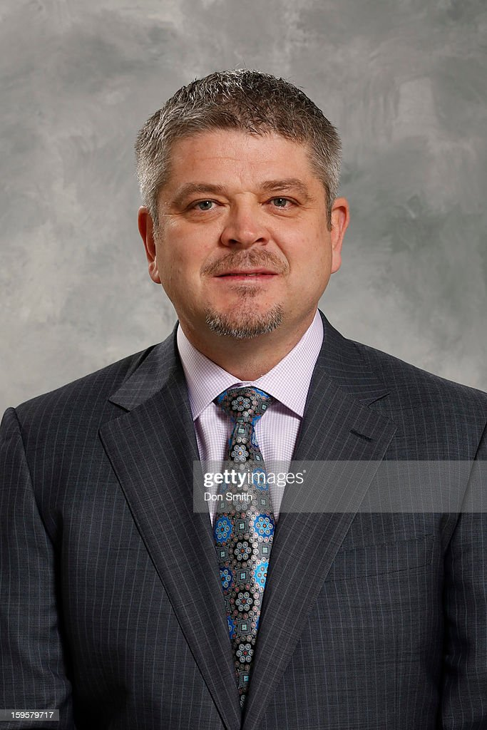 Todd McLellan of the San Jose Sharks poses for his official headshot for the 2012-13 season on January 13, 2013 at Sharks Ice in San Jose, California.