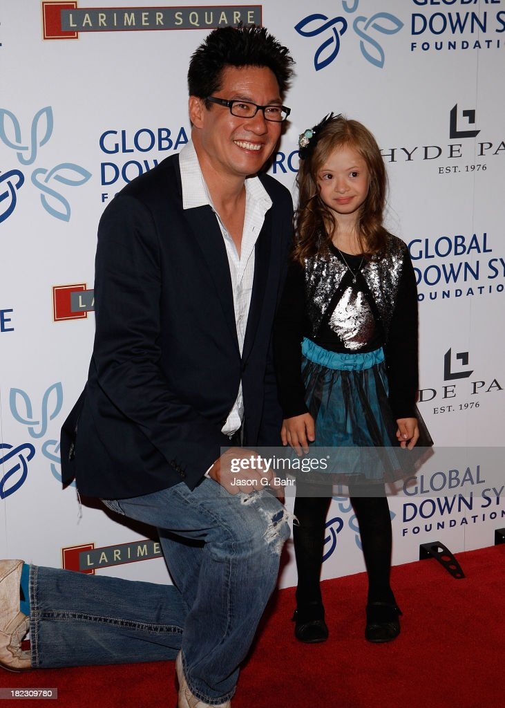 Todd Park Mohr of Bigg Head Todd & The Monsters poses with a young VIP at the Global Down Syndrome Foundation's Be Yourself Be Beautiful Fashion Show at Sheraton Downtown Denver Hotel on September 28, 2013 in Denver, Colorado.