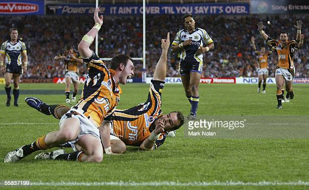 Todd Payten celebrates his last minute try with Liam Fulton in the 2005 NRL Grand Final between Wests Tigers and the North Queensland Cowboys at...