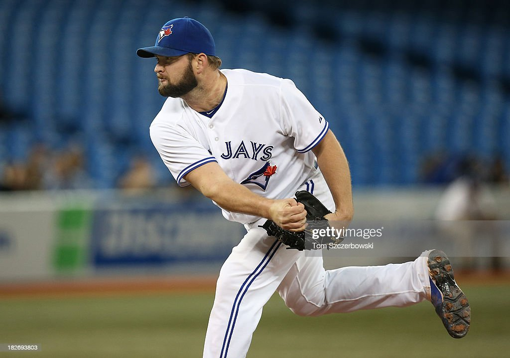 Todd Redmond #58 of the Toronto Blue Jays delivers a pitch during MLB game action against the Baltimore Orioles on September 13, 2013 at Rogers Centre in Toronto, Ontario, Canada. (Photo by Tom Szczerbowski/Getty Images) ~~~