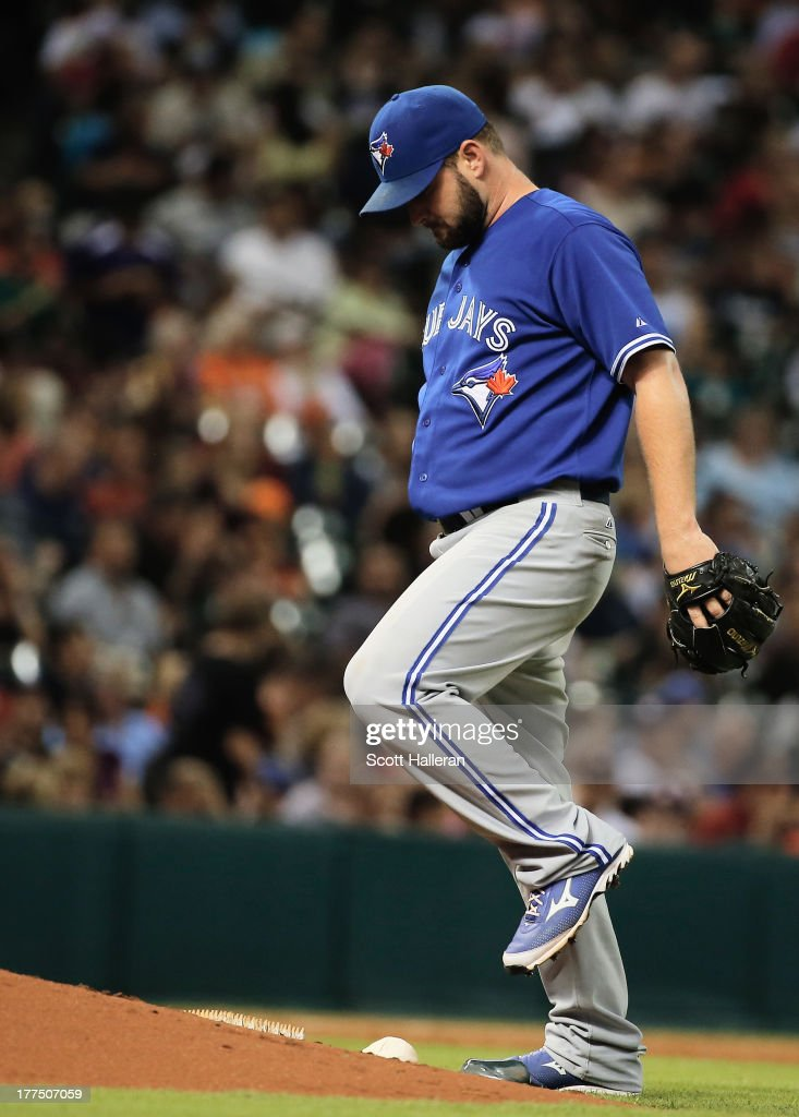 Todd Redmond #58 of the Toronto Blue Jays reacts to allowing a run in the third inning against the Houston Astros at Minute Maid Park on August 23, 2013 in Houston, Texas.