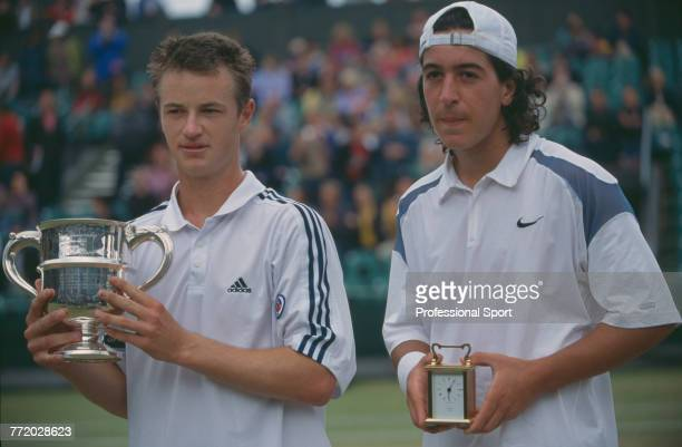 Todd Reid of Australia holds the trophy after defeating Lamine Ouahab of Algeria in the final of the boy's singles tennis tournament at the Wimbledon...