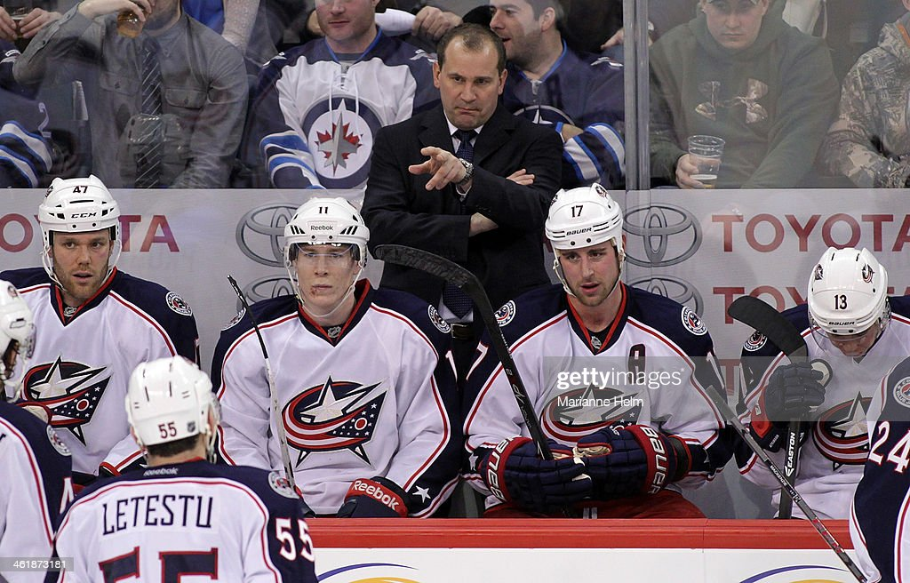 Todd Richards, head coach of the Columbus Blue Jackets, gestures from the bench in third period action in an NHL game against the Winnipeg Jets at the MTS Centre on January 11, 2014 in Winnipeg, Manitoba, Canada.