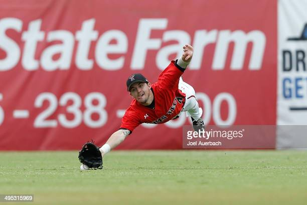 Todd Ritchie of the Texas Tech Red Raiders is unable to catch the ball hit by Tyler Palmer of the Miami Hurricanes in the eighth inning during the...
