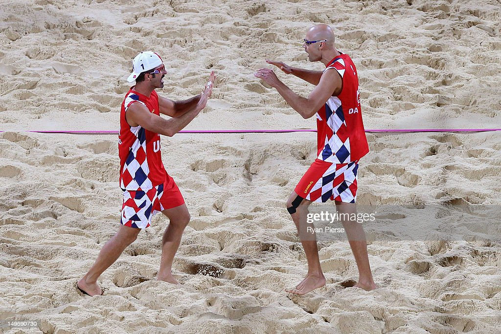Todd Rogers and Phil Dalhausser of United States celebrate victory during the Men's Beach Volleyball Preliminary match between the United States and Spain on Day 4 at Horse Guards Parade on July 31, 2012 in London, England.