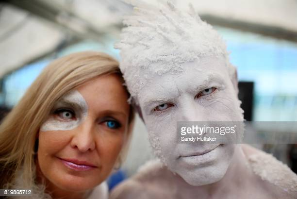 Todd Schmidt R and his wife name not given dressed as the Iceman at the San Diego Convention Center during Comic Con International on July 20 2017 in...