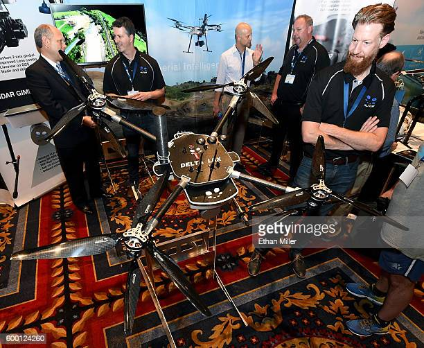 Todd Sedlak from Altus Unmanned Aerial Solutions stands by the company's Delta LRX drone at InterDrone an international drone conference and...
