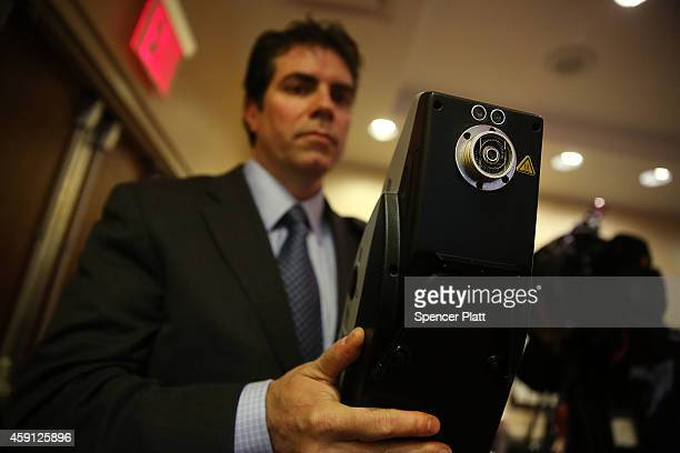 Todd Silvestri VP of Technology for Implant Sciences holds up a Quantum Sniffer device which is used to detect traces of explosive material on...