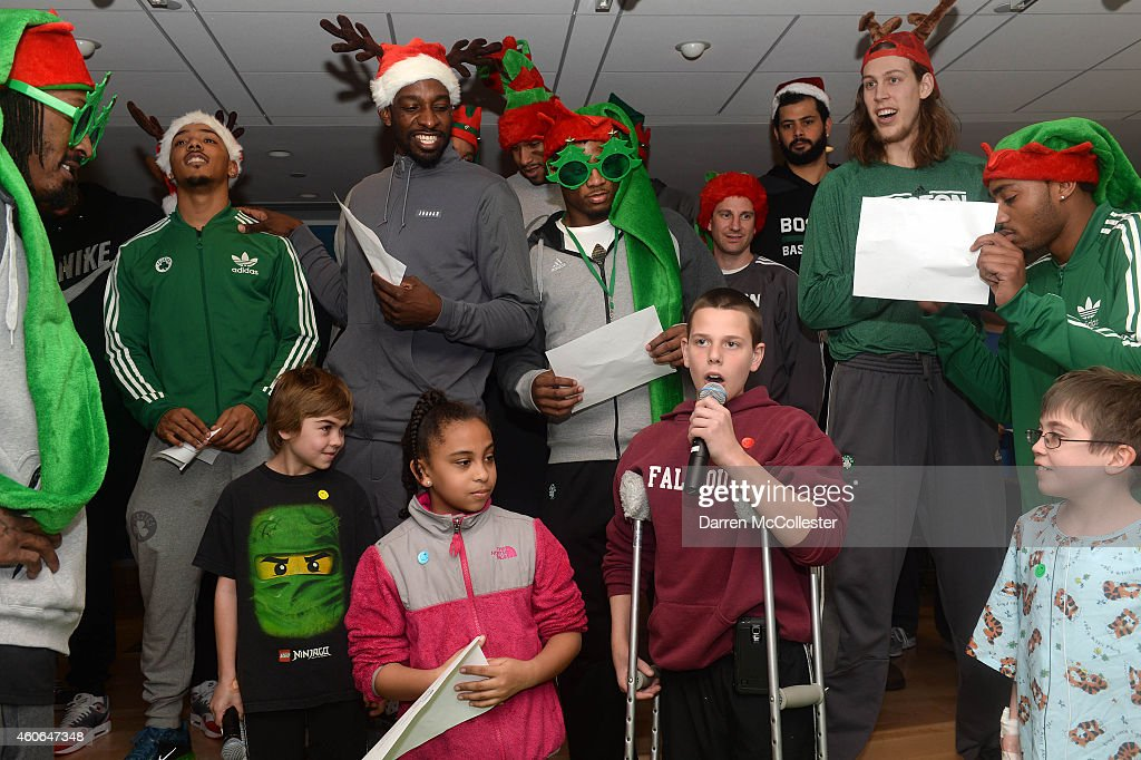 Todd sings along with Boston Celtics (L to R) Gerald Wallace, Phil Pressey, Jeff Green, Marcus Smart, Darren Erman, Vitor Faverani, Kelly Olynyk, and James Young during a Celtics holiday visit with the kids at Boston Children's Hospital December 18, 2014 in Boston, Massachusetts.