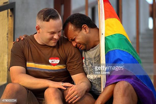BEACH CA Todd Stevens of Long Beach lends his shoulder to his husband Yael Deynes who broke down crying as a celebration at the Long Beach Civic...