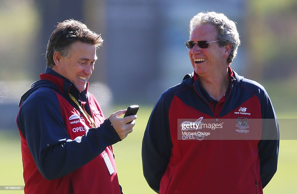 Todd Viney (L) reacts after reading a text on his phone during a Melbourne Demons AFL training session at Gosch's Paddock on May 2, 2013 in Melbourne, Australia.
