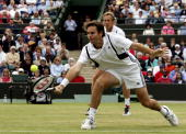 Todd Woodbridge of Australia and Jonas Bjorkman of Sweden in action during the doubles final match against Julian Knowle of Austria and Nenad...