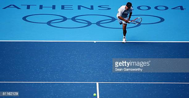 Todd Woodbridge of Australia serves during practice at the Athens 2004 Summer Olympic Games at the Olympic Sports Complex Tennis Centre on August 12...