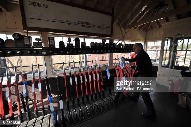 Toddington signal box signalman Keri Moreman activates signal levers