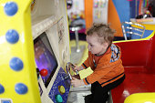 Toddler and amusement machine at indoor playground