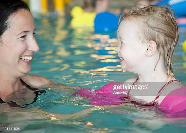 Toddler and mother playing in pool