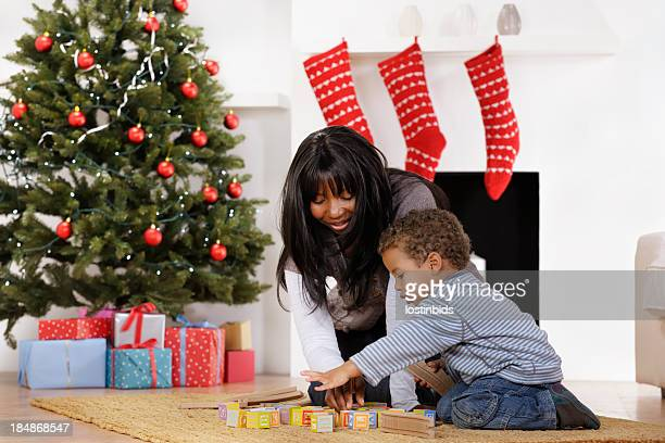Toddler and Mother Playing With Building Blocks At Christmas