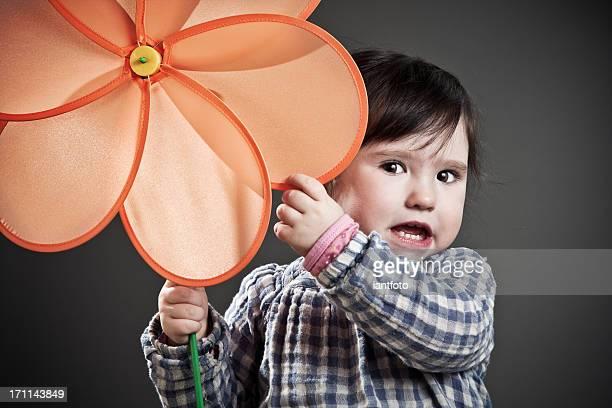 Toddler and orange flower.